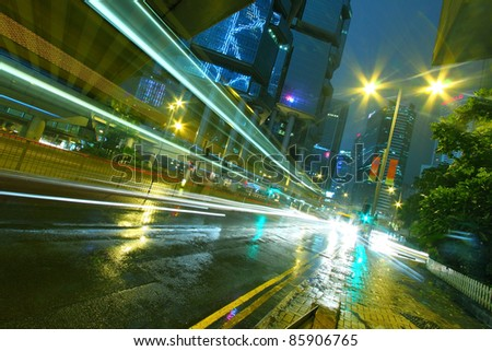Traffic in city at night with office buiidings background - stock photo