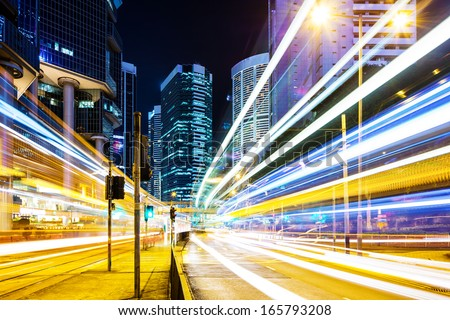 traffic in downtown at night - stock photo