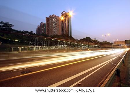 Traffic in downtown of Hong Kong at night - stock photo