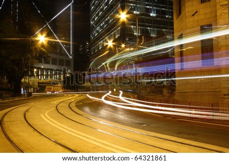 Traffic in downtown of Hong Kong at night - stock photo