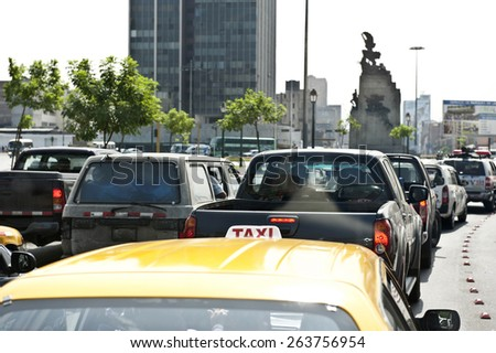 Traffic in Lima, Peru on a sunny day of a taxi in traffic. - stock photo