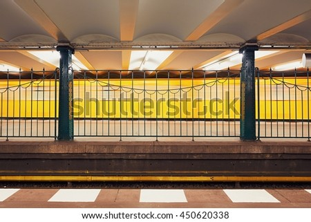 Traffic in subway. Blurred motion of the train in underground station of subway. Berlin, Germany  - stock photo