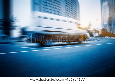 traffic in the downtown district,tianjin china, blurred