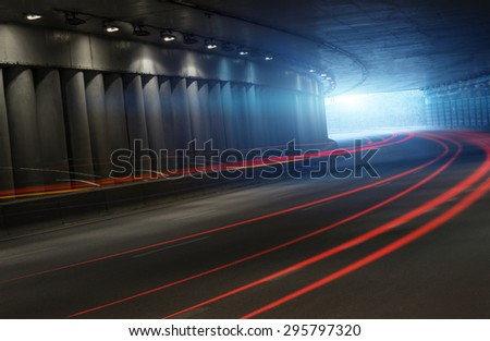 Traffic in tunnel, long exposure - stock photo