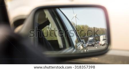 traffic jam in car mirror - stock photo