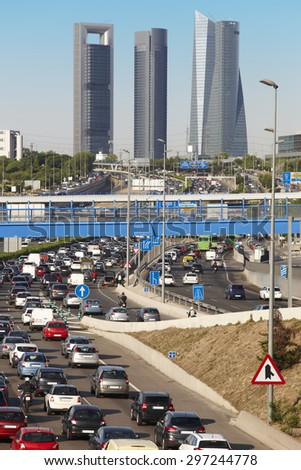 Traffic jam in Madrid with four towers skyline. Vertical - stock photo