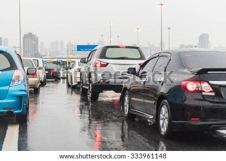 traffic jam on express way in raining day with many cars - stock photo