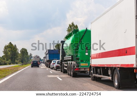 Traffic jam on highway. Waiting Cars Lines. Horizontal shot  - stock photo