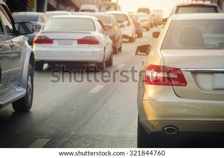 traffic jam with rows of cars during rush hour on road. - stock photo
