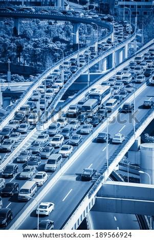 traffic jams on modern city highway junction - stock photo