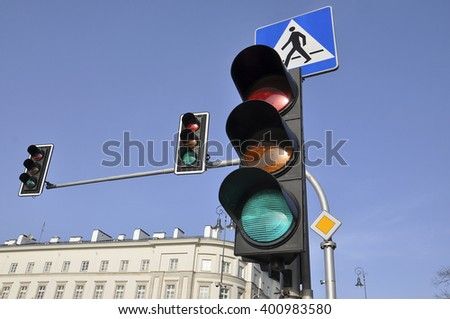 Traffic light against the blue sky and the pedestrian sign - stock photo