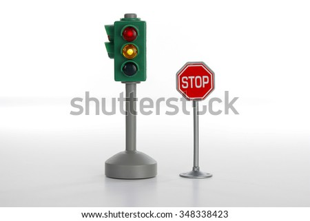 Traffic light and stop road sign on white background