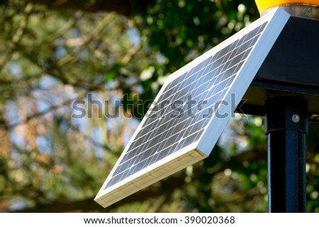 Traffic light from solar cell panel - stock photo