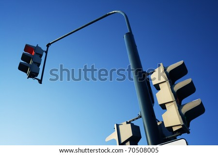 Traffic light on a background of the dark blue sky. A stoplight