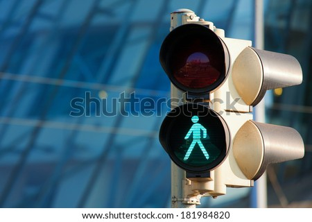 Traffic light on green - stock photo