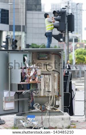 Traffic light repairman worker - stock photo