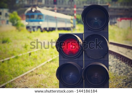 Traffic light shows red signal on railway - Railway station. - stock photo