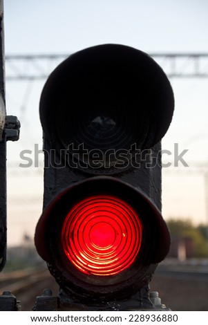 Traffic light shows red signal on railway. Red light - stock photo