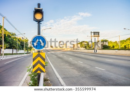 Traffic Light Signal, Road Markings and Pass Either Side , Dangerous Obstruction Warning Sign. They are in Bangkok city,  Thailand. - stock photo
