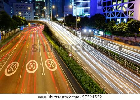 traffic light stream in city at night - stock photo