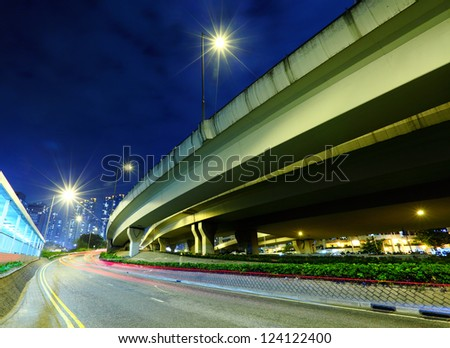 traffic light trails at night - stock photo