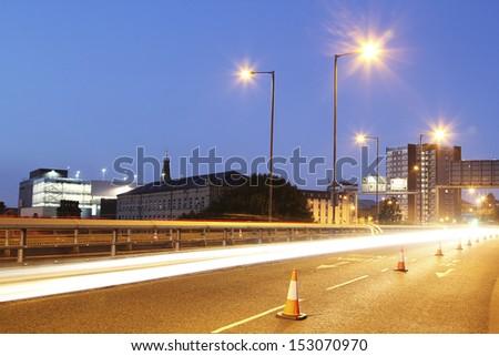 Traffic light trails crossing the Burdock Way, Halifax, West Yorkshire, England, UK - stock photo