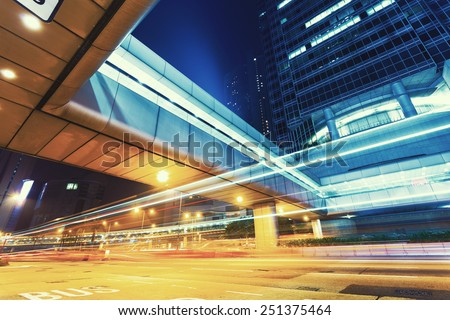 traffic light trails in modern city at night