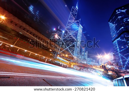 traffic light trails in modern city street