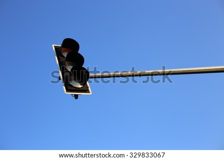 Traffic light with clear blue sky background.