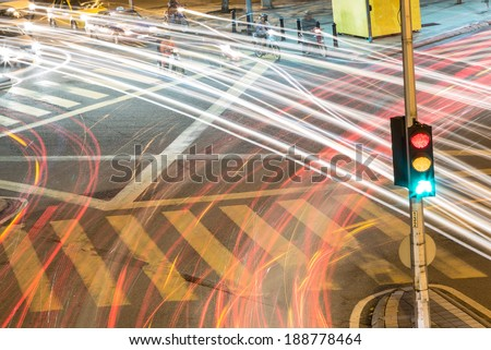 Traffic light with light streams from ongoing traffic - stock photo