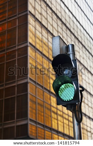 Traffic light with urban background - stock photo