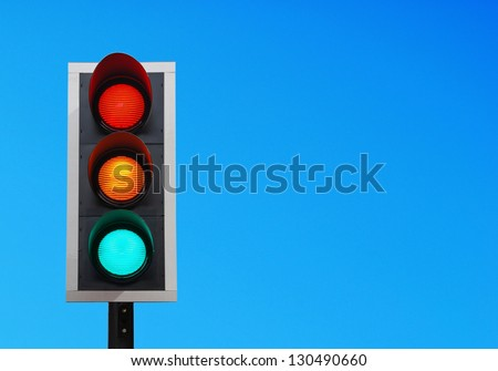traffic lights against a vibrant blue sky (copy-space ready for your design) - stock photo