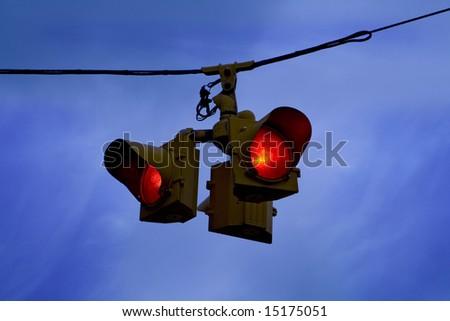 traffic lights against blue sky - stock photo