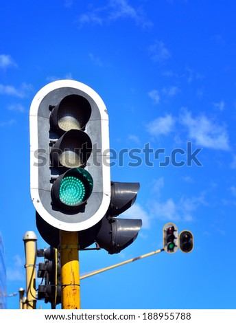 Traffic lights against blue sky - stock photo