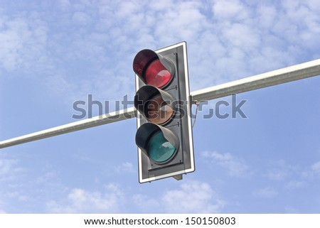 Traffic lights against sky backgrounds