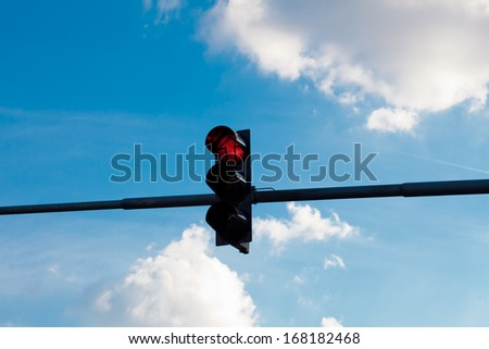 traffic lights against the blue sky