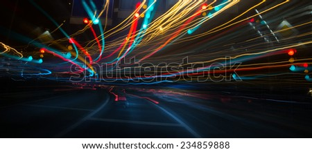 Traffic lights and cars, long exposure in motion - stock photo