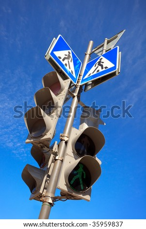 traffic lights and pedestrian sign at a crossroads - stock photo
