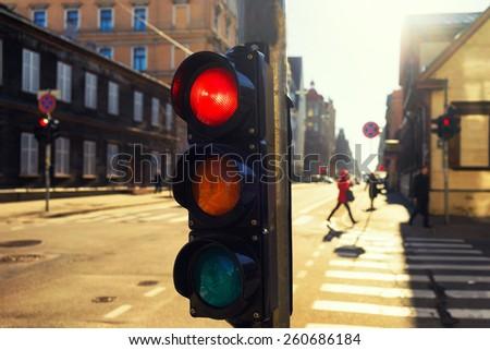Traffic lights at night outdoors at sunset. Riga, Latvia - stock photo