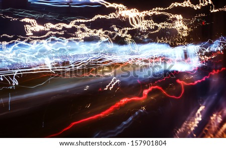 Traffic lights in motion blur, high contrast. - stock photo