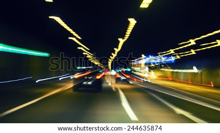 traffic lights in the night,light trace on highway - stock photo