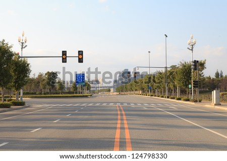 Traffic Lights Markings On City Junction Road In The Morning - stock photo