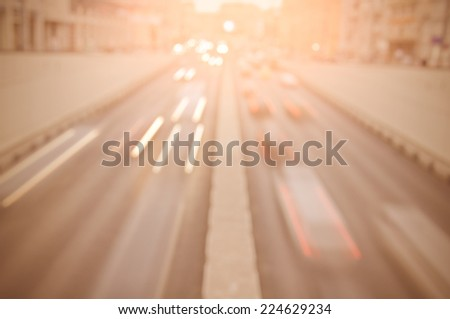 Traffic lights of the city road at sunset time. - stock photo