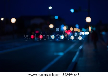 Traffic lights of the night city road. beautiful background of bokeh lights at night on road with car - stock photo
