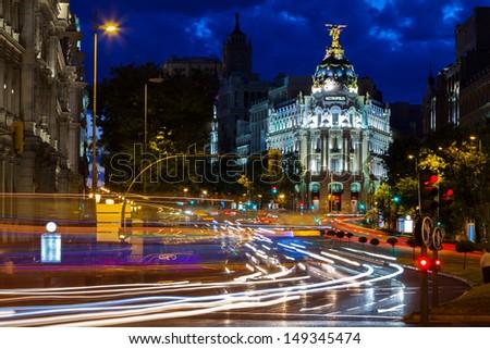 Traffic lights on Gran via street at night, Spain - stock photo