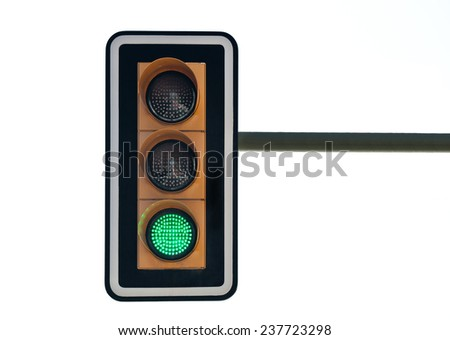 traffic lights with green isolated on white background - stock photo