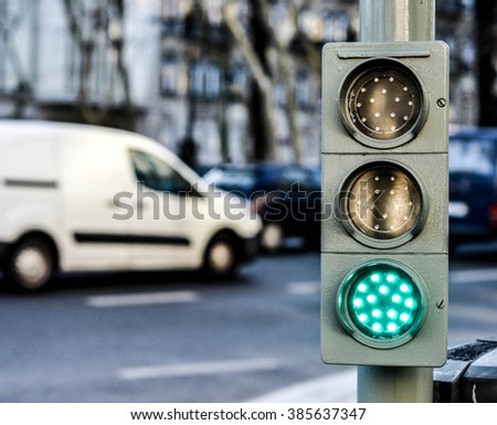 Traffic lights with green light for cars