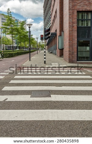 Traffic lights with pedestrian crossing. - stock photo