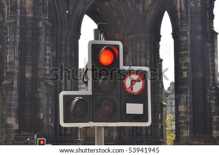 Traffic lights with red sign on street - stock photo