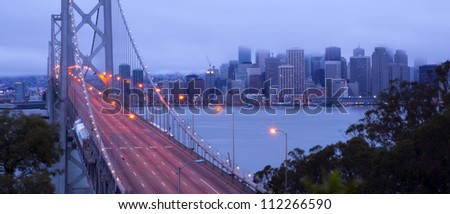 Traffic moves into downtown San Francisco early in the morning across the Bay Bridge - stock photo